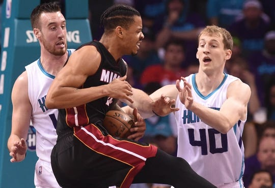 Apr 29, 2016; Charlotte, NC, USA; Miami Heat guard forward Gerald Green (14) gets fouled by Charlotte Hornets forward center Frank Kaminsky (44) during the first half in game six of the first round of the NBA Playoffs at Time Warner Cable Arena. Mandatory Credit: Sam Sharpe-USA TODAY Sports