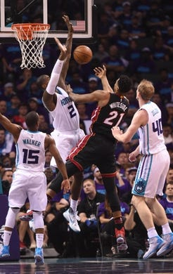 Apr 29, 2016; Charlotte, NC, USA; Miami Heat center Hassan Whiteside (21) moves to the basket as he is defended by Charlotte hornets forward Marvin Williams (2) and forward center Cody Zeller (40) during the first half in game six of the first round of the NBA Playoffs at Time Warner Cable Arena. Mandatory Credit: Sam Sharpe-USA TODAY Sports