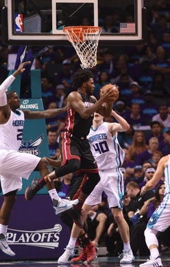 Apr 29, 2016; Charlotte, NC, USA; Miami Heat forward Justise Winslow (20) looks to pass the ball during the first half in game six of the first round of the NBA Playoffs against the Charlotte Hornets at Time Warner Cable Arena. Mandatory Credit: Sam Sharpe-USA TODAY Sports