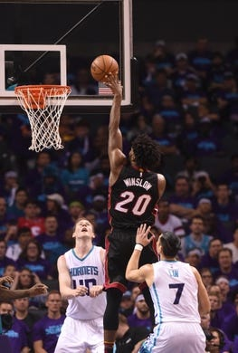 Apr 29, 2016; Charlotte, NC, USA; Miami Heat forward Justise Winslow (20) moves to the basket during the first half in game six of the first round of the NBA Playoffs against the Charlotte Hornets at Time Warner Cable Arena. Mandatory Credit: Sam Sharpe-USA TODAY Sports