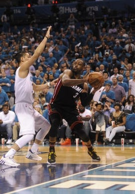 Apr 29, 2016; Charlotte, NC, USA; Miami Heat guard Dwyane Wade (3) looks to pass the ball as he is defended by Charlotte Hornets guard Jeremy Lin (7) during the second half in game six of the first round of the NBA Playoffs at Time Warner Cable Arena. Heat win 97-90. Mandatory Credit: Sam Sharpe-USA TODAY Sports