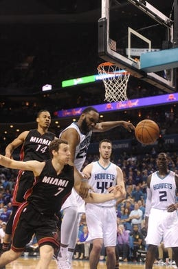 Apr 29, 2016; Charlotte, NC, USA; Charlotte Hornets forward center Al Jefferson (25) and Miami Heat guard Goran Tragic (7) fight for a rebound during the second half in game six of the first round of the NBA Playoffs at Time Warner Cable Arena. Heat win 97-90. Mandatory Credit: Sam Sharpe-USA TODAY Sports