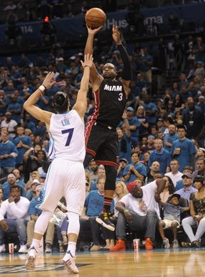 Apr 29, 2016; Charlotte, NC, USA; Miami Heat guard Dwyane Wade (3) shoots as he is defended by Charlotte Hornets guard Jeremy Lin (7) during the second half in game six of the first round of the NBA Playoffs at Time Warner Cable Arena. Heat win 97-90. Mandatory Credit: Sam Sharpe-USA TODAY Sports