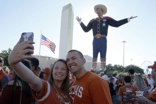 Oct 8, 2016; Dallas, TX, USA;  Texas Longhorns fans Gage and Lauren Whitman pose for a picture in front of Big Tex before the game against the Oklahoma Sooners at Cotton Bowl. Mandatory Credit: Tim Heitman-USA TODAY Sports