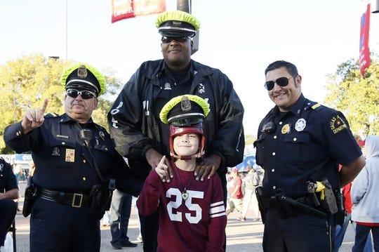 Oct 8, 2016; Dallas, TX, USA;  Oklahoma Sooners fan Joseph Kauffman poses with members of the Dallas police force before the game against the Texas Longhorns at Cotton Bowl. Mandatory Credit: Tim Heitman-USA TODAY Sports