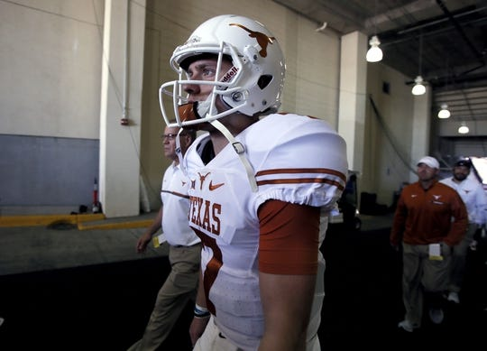 Oct 8, 2016; Dallas, TX, USA;  Texas Longhorns quarterback Shane Buechele (7) walks off the field before the game against the Oklahoma Sooners at Cotton Bowl. Mandatory Credit: Tim Heitman-USA TODAY Sports