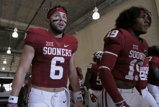 Oct 8, 2016; Dallas, TX, USA;  Oklahoma Sooners quarterback Baker Mayfield (6) walks off the field before the game against the Texas Longhorns at Cotton Bowl. Mandatory Credit: Tim Heitman-USA TODAY Sports