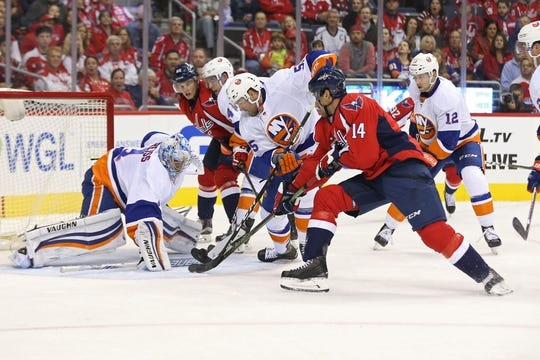 Oct 15, 2016; Washington, DC, USA; Washington Capitals right wing Justin Williams (14) and New York Islanders defenseman Johnny Boychuk (55) battle for the puck in front of Islanders goalie Thomas Greiss (1) in the first period at Verizon Center. Mandatory Credit: Geoff Burke-USA TODAY Sports