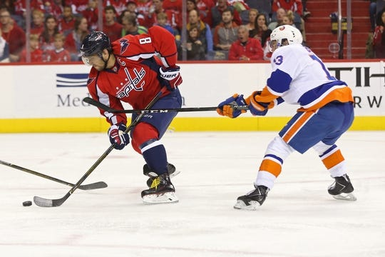 Oct 15, 2016; Washington, DC, USA; Washington Capitals left wing Alex Ovechkin (8) skates with the puck as New York Islanders center Mathew Barzal (13) defends in the first period at Verizon Center. Mandatory Credit: Geoff Burke-USA TODAY Sports