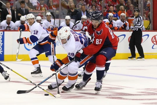 Oct 15, 2016; Washington, DC, USA; New York Islanders left wing Brock Nelson (29) skates with the puck as Washington Capitals center Zachary Sanford (82) defends in the second period at Verizon Center. Mandatory Credit: Geoff Burke-USA TODAY Sports
