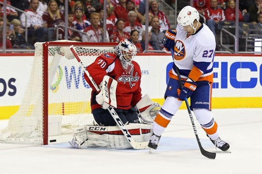 Oct 15, 2016; Washington, DC, USA; Washington Capitals goalie Braden Holtby (70) makes a save in front of New York Islanders left wing Anders Lee (27) in the second period at Verizon Center. Mandatory Credit: Geoff Burke-USA TODAY Sports
