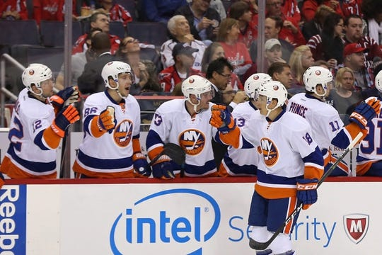 Oct 15, 2016; Washington, DC, USA; New York Islanders right wing Ryan Strome (18) celebrates with teammates after scoring a goal against the Washington Capitals in the second period at Verizon Center. The Capitals won 2-1. Mandatory Credit: Geoff Burke-USA TODAY Sports