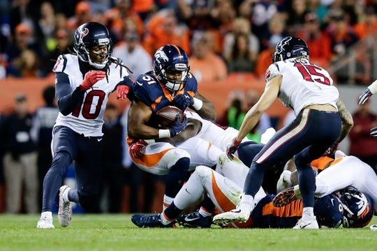 Oct 24, 2016; Denver, CO, USA; Denver Broncos inside linebacker Todd Davis (51) recovers a fumble against Houston Texans wide receiver DeAndre Hopkins (10) and wide receiver Will Fuller (15) in the third quarter at Sports Authority Field at Mile High. Mandatory Credit: Isaiah J. Downing-USA TODAY Sports