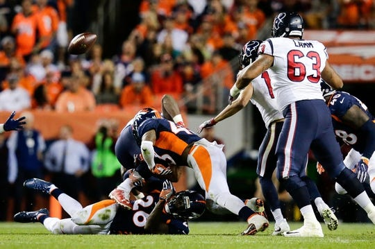 Oct 24, 2016; Denver, CO, USA; Houston Texans running back Alfred Blue (28) fumbles the ball against Denver Broncos free safety Darian Stewart (26) and strong safety T.J. Ward (43) as tackle Kendall Lamm (63) defends in the third quarter at Sports Authority Field at Mile High. Mandatory Credit: Isaiah J. Downing-USA TODAY Sports