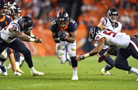 Oct 24, 2016; Denver, CO, USA; Houston Texans safety Lonnie Ballentine (39) and inside linebacker Benardrick McKinney (55) attempt to tackle a carry by Denver Broncos running back C.J. Anderson (22) in the second half at Sports Authority Field at Mile High. The Broncos defeated the Texans 27-9. Mandatory Credit: Ron Chenoy-USA TODAY Sports