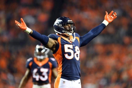 Oct 24, 2016; Denver, CO, USA;  Denver Broncos outside linebacker Von Miller (58) attempts to rally the crowd in the fourth quarter against the Houston Texans at Sports Authority Field at Mile High. The Broncos defeated the Texans 27-9. Mandatory Credit: Ron Chenoy-USA TODAY Sports