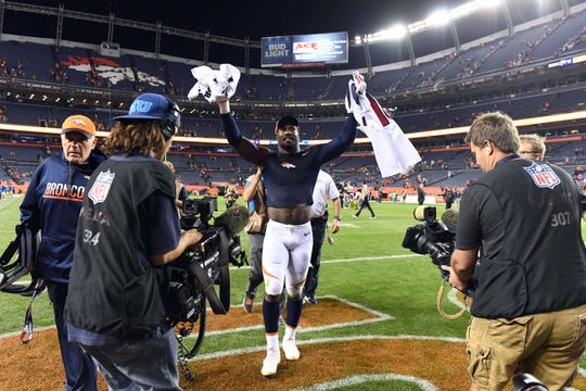 Oct 24, 2016; Denver, CO, USA; Denver Broncos outside linebacker Von Miller (58) celebrates the win over the Houston Texans at Sports Authority Field at Mile High. The Broncos defeated the Texans 27-9. Mandatory Credit: Ron Chenoy-USA TODAY Sports