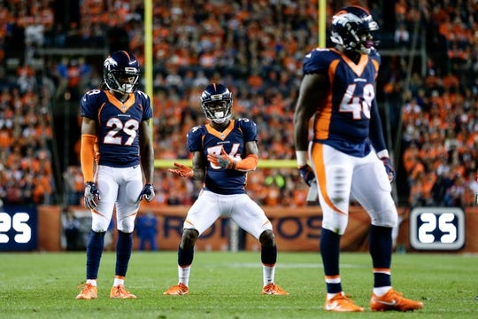 Oct 24, 2016; Denver, CO, USA; Denver Broncos defensive back Will Parks (34) dances next to free safety Bradley Roby (29) and outside linebacker Shaquil Barrett (48) in the fourth quarter against the Houston Texans at Sports Authority Field at Mile High. The Broncos won 27-9. Mandatory Credit: Isaiah J. Downing-USA TODAY Sports