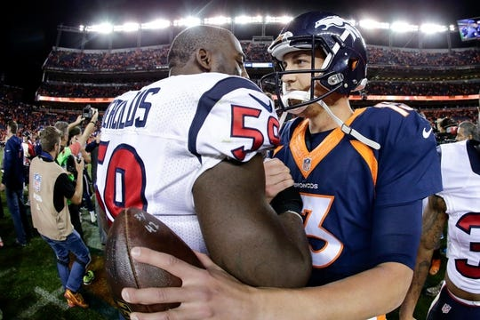 Oct 24, 2016; Denver, CO, USA; Houston Texans outside linebacker Whitney Mercilus (59) and Denver Broncos quarterback Trevor Siemian (13) greet each other after the game at Sports Authority Field at Mile High. The Broncos won 27-9. Mandatory Credit: Isaiah J. Downing-USA TODAY Sports