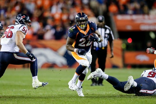 Oct 24, 2016; Denver, CO, USA; Denver Broncos running back C.J. Anderson (22) runs the ball against Houston Texans inside linebacker Brian Cushing (56) in the fourth quarter at Sports Authority Field at Mile High. The Broncos won 27-9. Mandatory Credit: Isaiah J. Downing-USA TODAY Sports