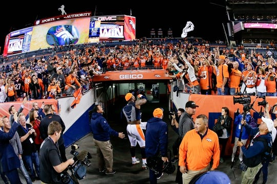 Oct 24, 2016; Denver, CO, USA; Denver Broncos outside linebacker Von Miller (58) throws a towel into the crowd after the game against the Houston Texans at Sports Authority Field at Mile High. The Broncos won 27-9. Mandatory Credit: Isaiah J. Downing-USA TODAY Sports