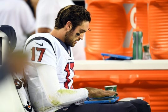 Oct 24, 2016; Denver, CO, USA; Houston Texans quarterback Brock Osweiler (17) looks at his tablet following a turnover in the second half against the Denver Broncos at Sports Authority Field at Mile High. The Broncos defeated the Texans 27-9. Mandatory Credit: Ron Chenoy-USA TODAY Sports