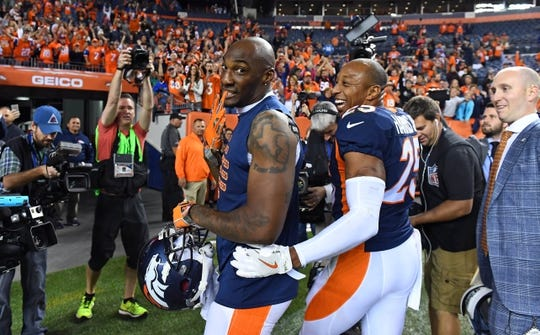 Oct 24, 2016; Denver, CO, USA; Denver Broncos cornerback Aqib Talib (21) and cornerback Chris Harris (25) celebrate the win over the Houston Texans in the second half at Sports Authority Field at Mile High. The Broncos defeated the Texans 27-9. Mandatory Credit: Ron Chenoy-USA TODAY Sports