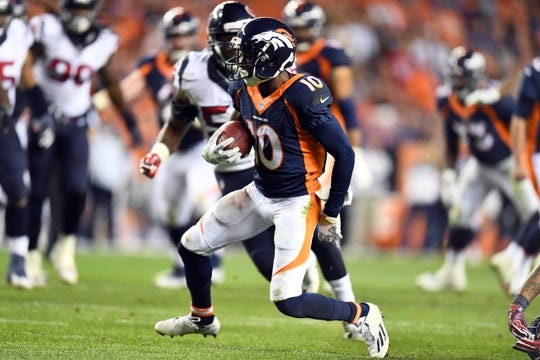 Oct 24, 2016; Denver, CO, USA;  Denver Broncos wide receiver Emmanuel Sanders (10) carries the ball in the second half against the Houston Texans at Sports Authority Field at Mile High. The Broncos defeated the Texans 27-9. Mandatory Credit: Ron Chenoy-USA TODAY Sports