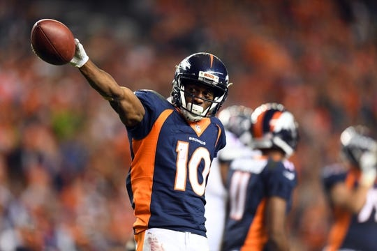 Oct 24, 2016; Denver, CO, USA; Denver Broncos wide receiver Emmanuel Sanders (10) celebrates a first down reception in the second half against the Houston Texans at Sports Authority Field at Mile High. The Broncos defeated the Texans 27-9. Mandatory Credit: Ron Chenoy-USA TODAY Sports