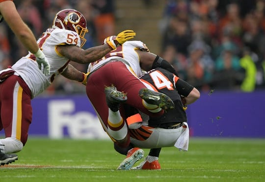 Oct 30, 2016; London, United Kingdom; Washington Redskins defensive end Chris Baker (92) and linebacker Mason Foster (54) sack Cincinnati Bengals quarterback Andy Dalton (14) in the second quarter during game 17 of the NFL International Series at Wembley Stadium. Mandatory Credit: Kirby Lee-USA TODAY Sports