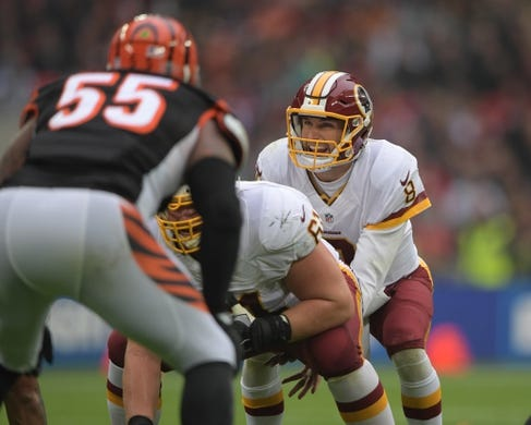 Oct 30, 2016; London, United Kingdom; Washington Redskins quarterback Kirk Cousins (8) prepares to take the snap from center Spencer Long (61) against the Cincinnati Bengals during game 17 of the NFL International Series at Wembley Stadium. Mandatory Credit: Kirby Lee-USA TODAY Sports
