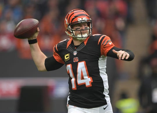 Oct 30, 2016; London, United Kingdom; Cincinnati Bengals quarterback Andy Dalton (14) throws a pass against the Washington Redskins during game 17 of the NFL International Series at Wembley Stadium. Mandatory Credit: Kirby Lee-USA TODAY Sports