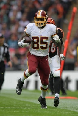 Oct 30, 2016; London, United Kingdom; Washington Redskins tight end Vernon Davis (85) carries the ball on a 44-yard reception in the second quarter against the Cincinnati Bengals during game 17 of the NFL International Series at Wembley Stadium. Mandatory Credit: Kirby Lee-USA TODAY Sports