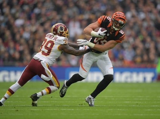 Oct 30, 2016; London, United Kingdom; Cincinnati Bengals tight end Tyler Eifert (85) is defended by Washington Redskins safety Donte Whitner Sr. (39) during game 17 of the NFL International Series at Wembley Stadium. Mandatory Credit: Kirby Lee-USA TODAY Sports