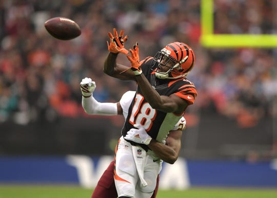 Oct 30, 2016; London, United Kingdom; Cincinnati Bengals wide receiver A.J. Green (18) is defended by Washington Redskins cornerback Josh Norman (24) in the second quarter during game 17 of the NFL International Series at Wembley Stadium. Mandatory Credit: Kirby Lee-USA TODAY Sports