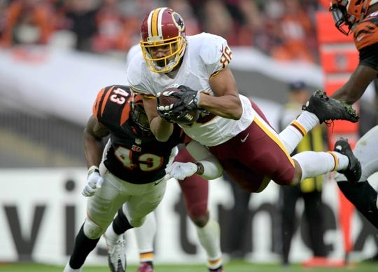 Oct 30, 2016; London, United Kingdom; Washington Redskins tight end Jordan Reed (86) dives into the end zone on a 23-yard touchdown reception in the third quarter against the Cincinnati Bengals during game 17 of the NFL International Series at Wembley Stadium. The Redskins and Bengals tied 27-27. Mandatory Credit: Kirby Lee-USA TODAY Sports