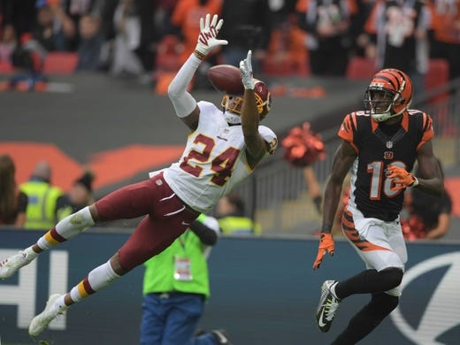 Oct 30, 2016; London, United Kingdom; Washington Redskins cornerback Josh Norman (24) deflects a pass intended for Cincinnati Bengals wide receiver A.J. Green (18) during game 17 of the NFL International Series at Wembley Stadium. The Redskins and Bengals tied 27-27. Mandatory Credit: Kirby Lee-USA TODAY Sports