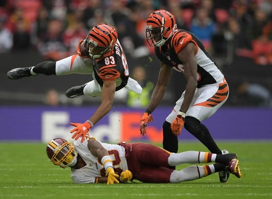 Oct 30, 2016; London, United Kingdom; Cincinnati Bengals wide receiver Tyler Boyd (83) is tackled by Washington Redskins cornerback Kendall Fuller (38) during game 17 of the NFL International Series at Wembley Stadium. The Redskins and Bengals tied 27-27. Mandatory Credit: Kirby Lee-USA TODAY Sports