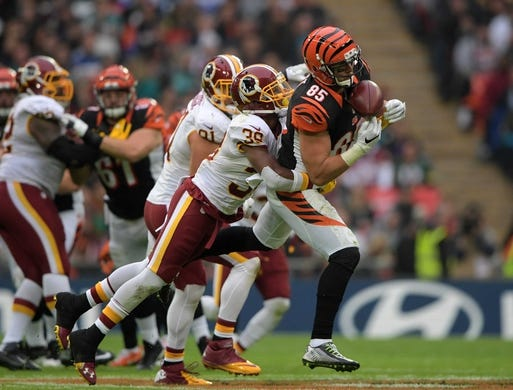 Oct 30, 2016; London, United Kingdom; Cincinnati Bengals tight end Tyler Eifert (85) catches a pass as Washington Redskins safety Donte Whitner Sr. (39) defends during game 17 of the NFL International Series at Wembley Stadium. The Redskins and Bengals tied 27-27 tie. Mandatory Credit: Kirby Lee-USA TODAY Sports