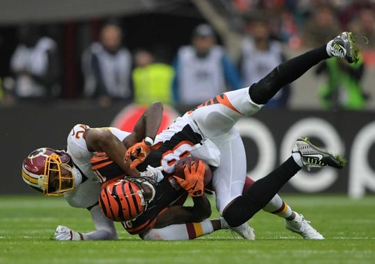 Oct 30, 2016; London, United Kingdom; Cincinnati Bengals wide receiver A.J. Green (18) is tackled by Washington Redskins cornerback Josh Norman (24) during game 17 of the NFL International Series at Wembley Stadium. The Redskins and Bengals tied 27-27. Mandatory Credit: Kirby Lee-USA TODAY Sports