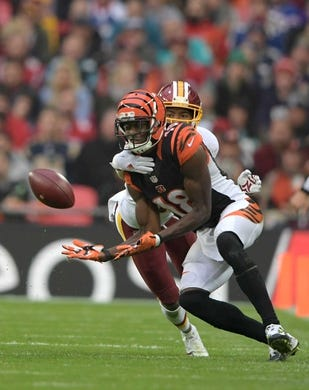 Oct 30, 2016; London, United Kingdom; Cincinnati Bengals wide receiver A.J. Green (18) is defended by Washington Redskins cornerback Josh Norman (24) during game 17 of the NFL International Series at Wembley Stadium. The Redskins and Bengals tied 27-27. Mandatory Credit: Kirby Lee-USA TODAY Sports