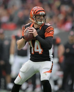 Oct 30, 2016; London, United Kingdom; Cincinnati Bengals quarterback Andy Dalton (14) throws a pass against the Washington Redskins during game 17 of the NFL International Series at Wembley Stadium. The Redskins and Bengals tied 27-27. Mandatory Credit: Kirby Lee-USA TODAY Sports