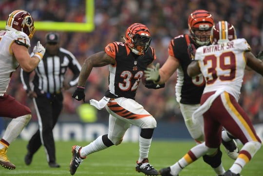 Oct 30, 2016; London, United Kingdom; Cincinnati Bengals running back Jeremy Hill (32) carries the ball against the Washington Redskins during game 17 of the NFL International Series at Wembley Stadium. The Redskins and Bengals tied 27-27. Mandatory Credit: Kirby Lee-USA TODAY Sports