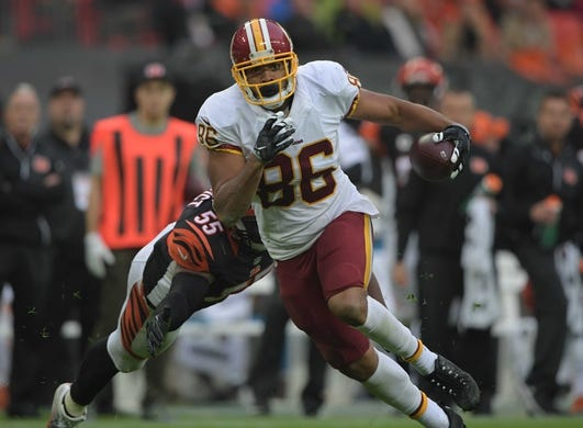 Oct 30, 2016; London, United Kingdom; Washington Redskins tight end Jordan Reed (86) carries the ball on a 23-yard touchdown reception in the third quarter against the Cincinnati Bengals during game 17 of the NFL International Series at Wembley Stadium. The Redskins and Bengals tied 27-27. Mandatory Credit: Kirby Lee-USA TODAY Sports