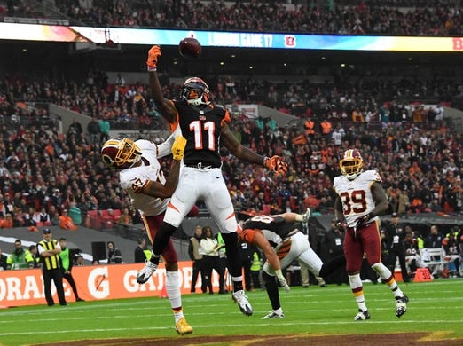 Oct 30, 2016; London, United Kingdom; Cincinnati Bengals wide receiver Brandon LaFell (11) attempts to catch a pass while defended by Washington Redskins cornerback Quinton Dunbar (47) during game 17 of the NFL International Series at Wembley Stadium. Dunbar was penalized for pass interference. The Redskins and Bengals tied 27-27. Mandatory Credit: Kirby Lee-USA TODAY Sports