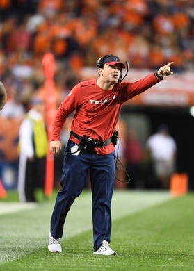 Oct 24, 2016; Denver, CO, USA; Houston Texans secondary coach John Butler calls out from the sidelines in the first half against the Houston Texans at Sports Authority Field at Mile High. Mandatory Credit: Ron Chenoy-USA TODAY Sports