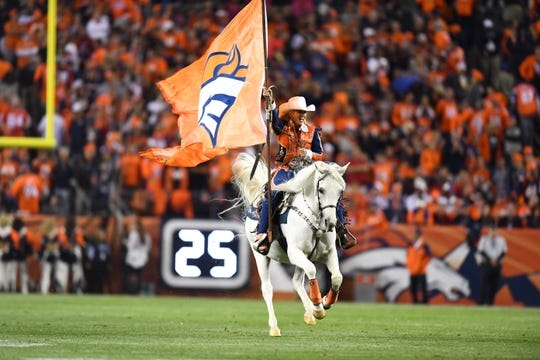 Oct 24, 2016; Denver, CO, USA; Denver Broncos mascot Thunder is rode by Ann Judge-Wegener following a field goal in the second half against the Houston Texans at Sports Authority Field at Mile High. The Broncos defeated the Texans 27-9. Mandatory Credit: Ron Chenoy-USA TODAY Sports