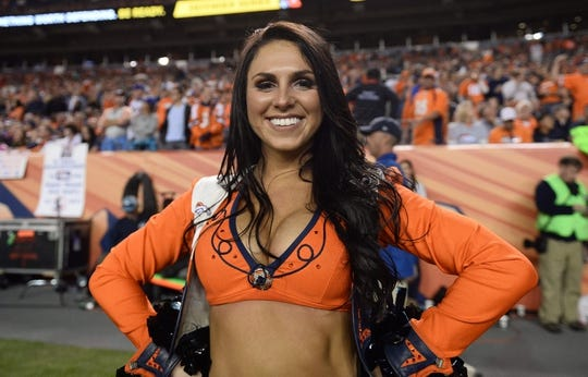 Oct 24, 2016; Denver, CO, USA; Denver Broncos cheerleader poses for a photo in the second half against the Houston Texans at Sports Authority Field at Mile High. The Broncos defeated the Texans 27-9. Mandatory Credit: Ron Chenoy-USA TODAY Sports