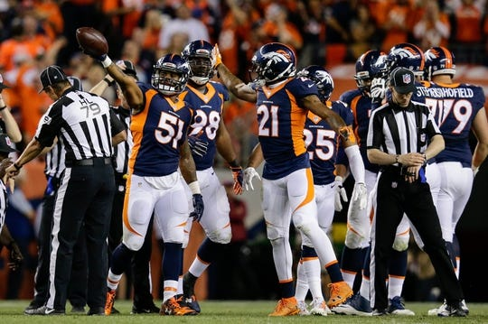 Oct 24, 2016; Denver, CO, USA; Denver Broncos inside linebacker Todd Davis (51) celebrates with cornerback Aqib Talib (21) after recovering a fumble in the third quarter against the Houston Texans at Sports Authority Field at Mile High. Mandatory Credit: Isaiah J. Downing-USA TODAY Sports