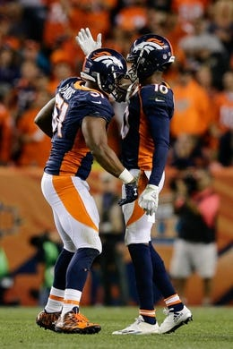 Oct 24, 2016; Denver, CO, USA; Denver Broncos inside linebacker Todd Davis (51) celebrates with wide receiver Emmanuel Sanders (10) after recovering a fumble in the third quarter against the Houston Texans at Sports Authority Field at Mile High. Mandatory Credit: Isaiah J. Downing-USA TODAY Sports